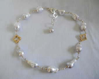 Baroque pearls with accents of silver and gold quatrefoils