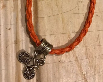 Orange Braided Leather Bracelet With Cycling Charm & Good Luck Bead