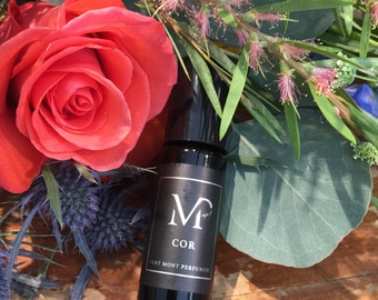 COR - Sweet Orange, Vetiver, Rosewood, Cypress & Moroccan Rose Absolute.