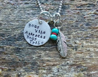 your vibe attracts your tribe hand stamped pendant. Your choice of either Necklace or Keychain