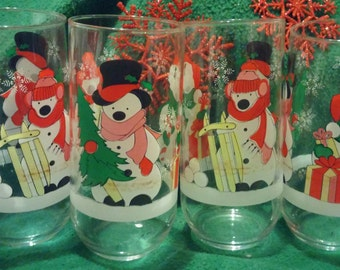 A Set of Four Colorful Holiday / Christmas Snowmen Tumblers / Juice Glasses