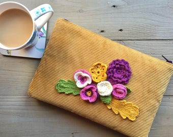 Crochet flowers on velvet clutch