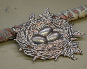 "4.5"" wide x 3.5: tall birds nest with eggs"