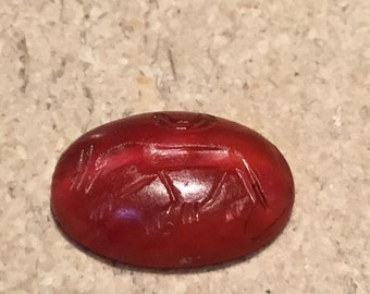 Antique carved carnelian with a symbol of a fox and moon