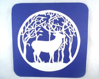 Dark blue square card white papercutting deer trees branches leaves