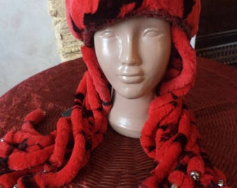Red hat made of mink. Mowed mink is a bereg. Winter jellyfish hat