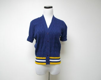 short sleeved blue cardigan . fits a small to medium