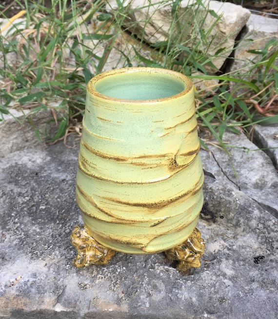 ceramic vase in beige, golden yellow, and pale green