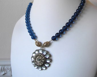 Blue Glass and Gold Filigree Beaded Necklace with Ornate Pale Blue Rhinestone Pendant