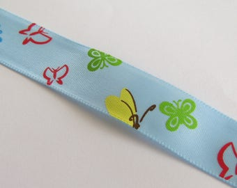 Pretty Blue Ribbon with multicolored butterflies pattern