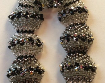 The Olympus bracelet and a mix of Czech seed beads and Hematite. It has a super chic look. It will make you a star!