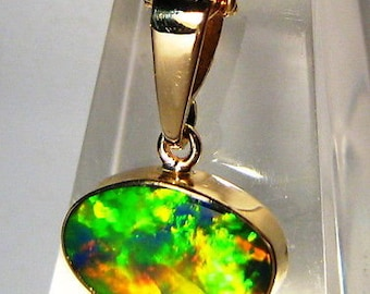 Solar Flare Bright!  AUS Opal 4.9cts inlay on black boulder 14k solid gold pendant