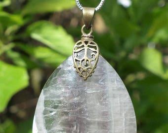 Fluorite pendant with brass bail