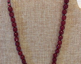 Ruby necklace knotted on cotton cord