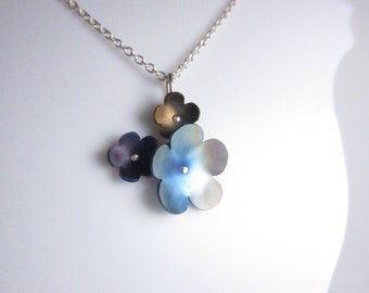 Sterling silver and titanium three flower pendant and chain