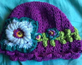 Purplish cotton childs hat with flowers
