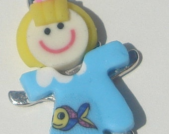 Yellow haired girl in happy blue dress with a fish design polymer clay pendant with bail