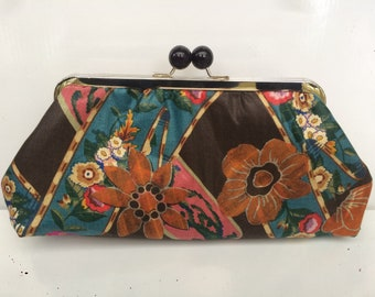 Handmade vintage fabric clutch with a metal frame