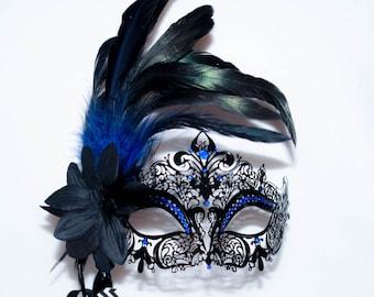 masquerade mask, masquerade mask with a stick and feathers, laser cut metal mask black and blue crystals and blue feathers
