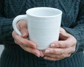 Set of two simple curved stoneware mugs - glazed in brilliant white
