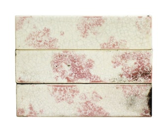 Set of 11 pink and white decorative tiles