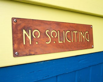 No Soliciting Sign in Rusted Steel Mission