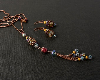 Beadwoven set: earrings and pendant with pearl and tassel
