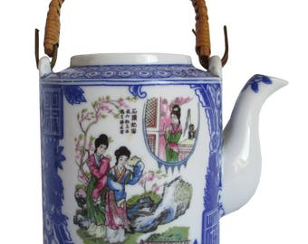 Blue white teapot with rattan handle.