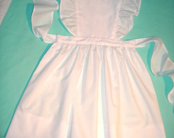 Pinafore Jumper Dress in White broadcloth with eyelet flutter sleeves.  Sizes 4 to 6X.  Made to Order.