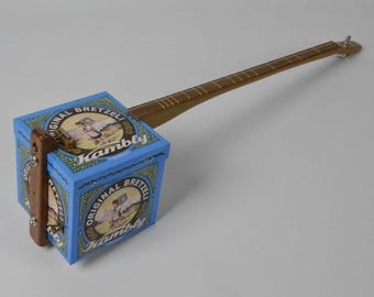 A Lovely Swiss Bretzeli Biscuit Tin Electro Acoustic Canjo, One String Guitar, Diddley Bow, Cigar Box Guitar, Cookie Tin Guitar, Electric