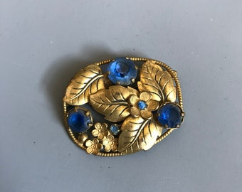 1930s brooch with blue glass