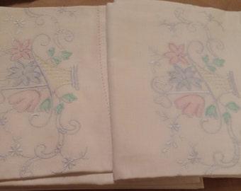 2 machine cross stitch pillowcases. MINT never used. Pastel flower baskets. Standard 24x35.