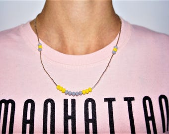 ethnic woman in yellow-gray faceted beads necklace