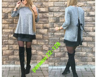 Women's knitted blouse of natural angora