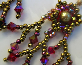 Ruby crystal and gold earrings