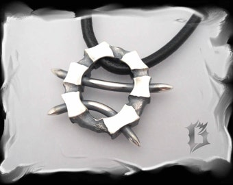Sterling silver circular pendant with spikes - oxidized #584