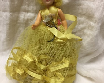 vintage yellow haired doll with yellow dress 1950s