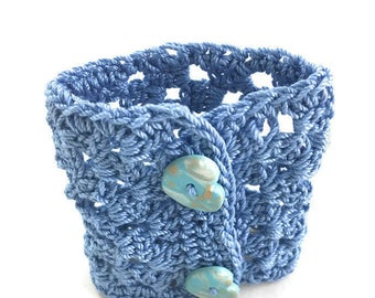 Small blue crochet cuff bracelet with heart buttons