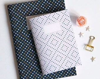 White notebook with polka dots