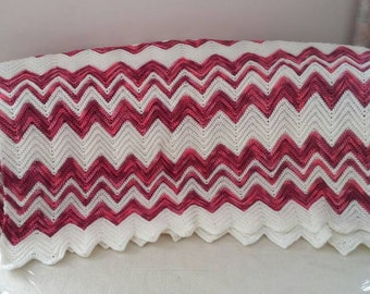 Pink shandes and cream chevron striped Afghan.