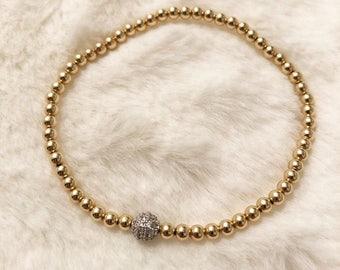 14k gold 3mm beaded bracelet with silver plated pave CZ bead; gold stack bracelet