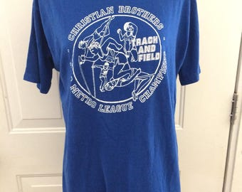 Vintage 1980's chrisitan brothers track and field tshirt. Size M/L ( mens)