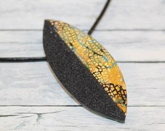 Black and gold leaf necklace