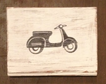 Black and White Vespa Scooter on Repurposed Wood