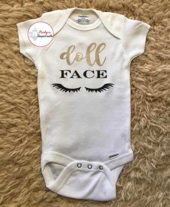 193458f89b81 Doll Face Eye Lashes Funny Baby Onesie Coming Home Outfit
