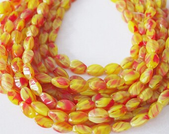 Strand Glass Beads Oval 4 Sided Yellow Red Swirl Size 13 x 6.5mm QTY 24 beads