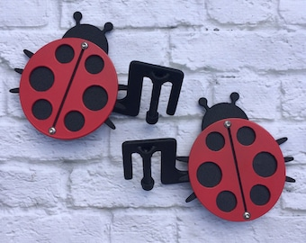 Two layer ladybug design Jeep foot pegs