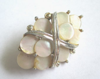 Vintage Brooch/Pin made up of small Mother of Pearl pieces. Elegant.
