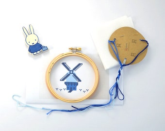 Cross stitch kit of a Dutch windmill. Delft Blue windmill embroidery kit including embroidery ring. Netherlands cross stitch