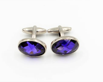 Oval silver tone cuff links with purple faceted glass inlays
